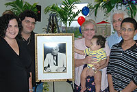 Surrounding a portrait of the late National Hero, James M Bodden are his sister Mary (holding her grandson Tariq), along with other members of the Trumbach family - (L-R) Tina, Nicholas, Michel and Nathan.